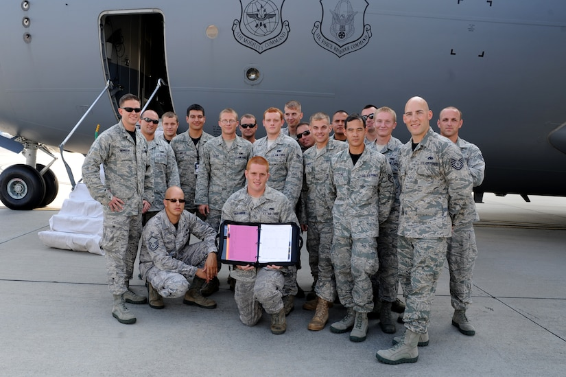 """Airmen from the 437th Maintenance Group proudly display their """"black letter initial"""" discrepency report July 22, shortly before the C-17 they worked on departed for Joint Base Lewis-McChord, Wa., for the Air Mobility Command Rodeo 2011. U.S. Air Force photo/Staff Sgt. Nicole Nicole)"""