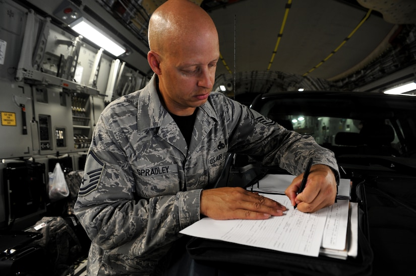 Master Sgt. Terrence Spradley signs the discrepency form in black ink signifiying the C-17 aircraft he and his team worked on for Rodeo 2011 had zero discrepencies. Spradly is the 437th Maintenance Group superintendent.