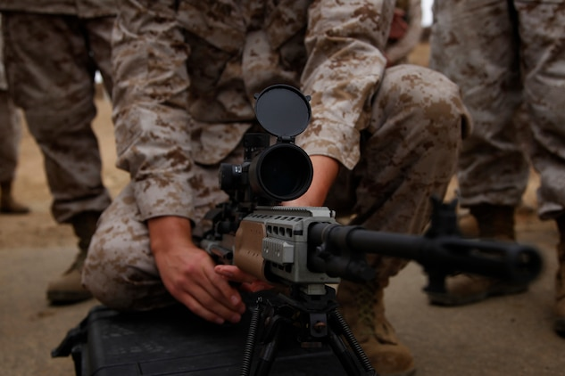 A Marine with the 15th Marine Expeditionary Unit (MEU) Command Element gets a feel for an Enhanced Marksmanship Rifle (EMR) as a part of a familiarization fire range conducted on Camp Pendleton, July 26-27.