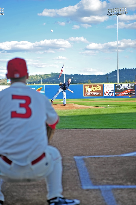Col. Marc C. Van Wert, 92 Air Refueling Wing vice commander, throws the first pitch at a Spokane Indians baseball game at the Avista Stadium, Spokane, Wash.,  July 22, 2011. The Spokane Indians are the class A short-season affiliate of the Texas Rangers. (U.S. Air Force photo/ Airman 1st Class Taylor Curry)