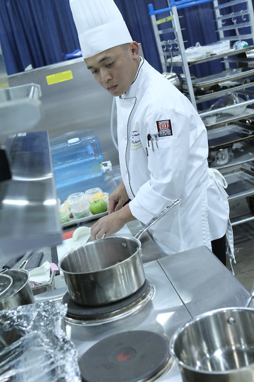Staff Sgt. Ghil Medina, a 633rd Force Support Squadron services journeyman, tries to beat the clock while preparing a meal for the American Culinary Federation's National Student Chef of the Year Award competition at the 2011 ACF National Convention in Dallas on July 24, 2011. While he ultimately did not win this award, Medina has won numerous awards in the military food services community, including being the first Airman to win the 2011 Armed Forces Junior Chef of the Year Award. (Photo courtesy of the American Culinary Federation)