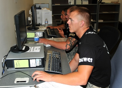 Airmen input data into an electronic database, July 27, 2011 at Joint Base Lewis-McChord, Wash., during an in-transit visibility competition. The event was part of Air Mobility Rodeo 2011, a biennial international competition that focuses on mission readiness, featuring airdrops, aerial refueling and other events that showcase the skills of mobility crews from around the world. (U.S. Air Force photo/Airman 1st Class Jared Trimarchi)