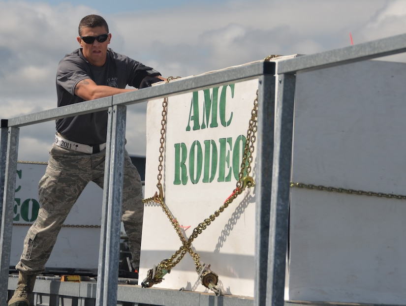 Staff Sgt. Matt Lumm from Team Charleston's Rodeo team pushes a simulated cargo pallet from the K-loader onto the highline dock during the 25K loader obstacle course at the Air Mobility Command Rodeo 2011 at Joint Base Lewis-McChord, Wash., July 27. (U.S. Air Force photo/2nd Lt. Susan Carlson)