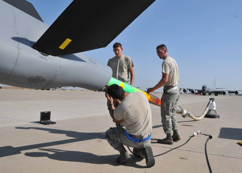 Airman Barrett I. Goulding (left), Airman 1st Class Timothy D. Donahoo (middle), and Staff Sgt. Lance I. Urey perform an hourly post-flight inspection on the air refueling boom of a KC-135 Stratotanker while deployed with the 313th Air Expeditionary Wing in Western Europe on July 28, 2011.