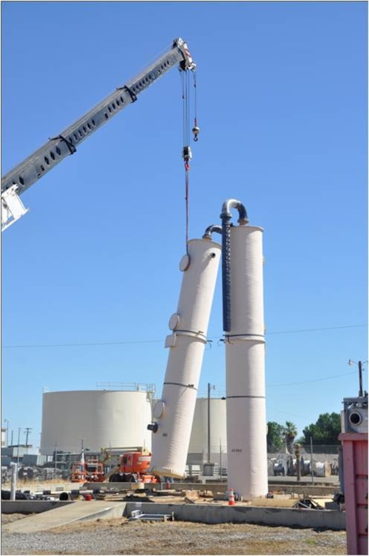 A crane  removes the first of two air stripper towers that were used to treat contaminated groundwater at the former  Castle Air Force Base in Atwater, Calif. The air stripping towers removed volatile organic compounds, primarily trichloroethene, a solvent used when the base was active.