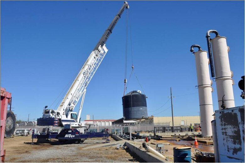 A crane  removes the second of two 13,800 gallon holding tanks that were part of a groundwater treatment plant at the former  Castle Air Force Base in Atwater, Calif.  The Air Force is removing the treatment system because it had completed its purpose of addressing groundwater contamination in the central base area.  Two additional treatment systems continue to address the remaining groundwater cleanup.