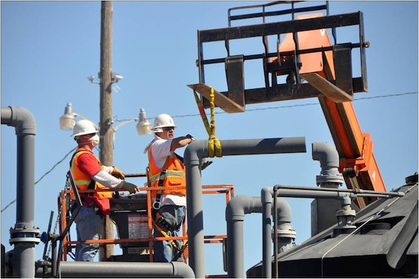 Construction workers removing pipes from one of the groundwater treatment systems at the former Castle Air Force Base in Atwater, Calif. The Air Force has two additional groundwater treatment systems that continue to operate on the former base. This system had achieved its goal and is no longer needed for groundwater cleanup.