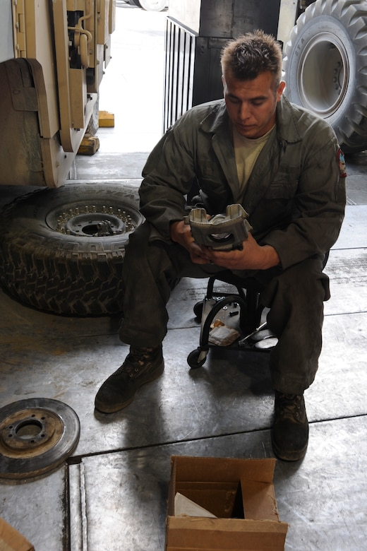 Staff Sgt. Jeffrey Kukuk inspects a brake caliper at the Transit Center at Manas, Kyrgyzstan, July 26. Kukuk is a 376th Expeditionary Logistics Readiness Squadron fire truck maintainer deployed here from Dover Air Force Base, Del. (U.S. Air Force photo/Tech. Sgt. Tammie Moore)