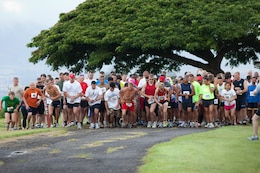 The 211 runners take their first steps toward the Aiea trails running the Mairne Corps Community Services Hawaii Camp H.M. Smith Semper Fit Center's 15th annual 5K Grueler held at Camp Smith.