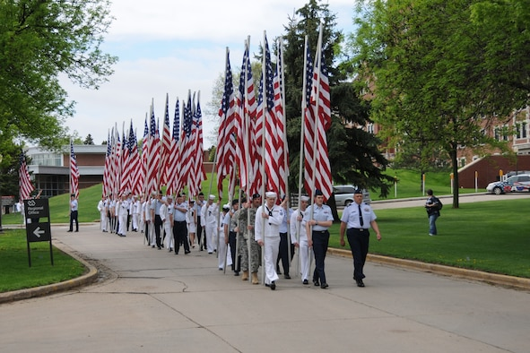 """SIOUX FALLS, SD - Members of the military, including members of the 114th Fighter Wing, South Dakota Air National Guard, participated in the annual Armed Forces Day parade held at the Sioux Falls Regional Veterans Administration Hospital on May 21.  The """"Parade of Flags"""" is a tradition at this annual event that honors both past and present members of the military. (Air Force photo by Master Sgt. Nancy Ausland, RELEASED)"""