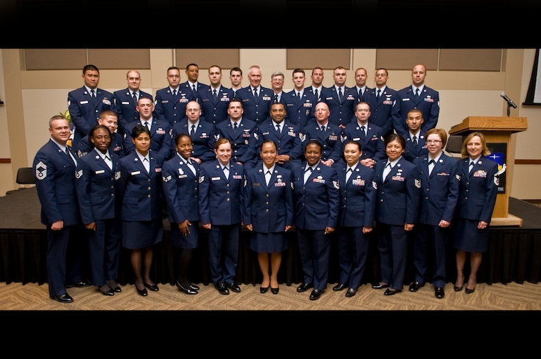 BUCKLEY AIR FORCE BASE, Colo. -- More than 30 of Team Buckley's 80 Community College of the Air Force graduates pose for a group photo May 26, 2011. Joining them is CCAF Vice Commandant Chief Master Sgt. James Pepin, bottom left, who served as guest speaker for the graduation. (U.S. Air Force graphic by Staff Sgt. Kathrine McDowell)