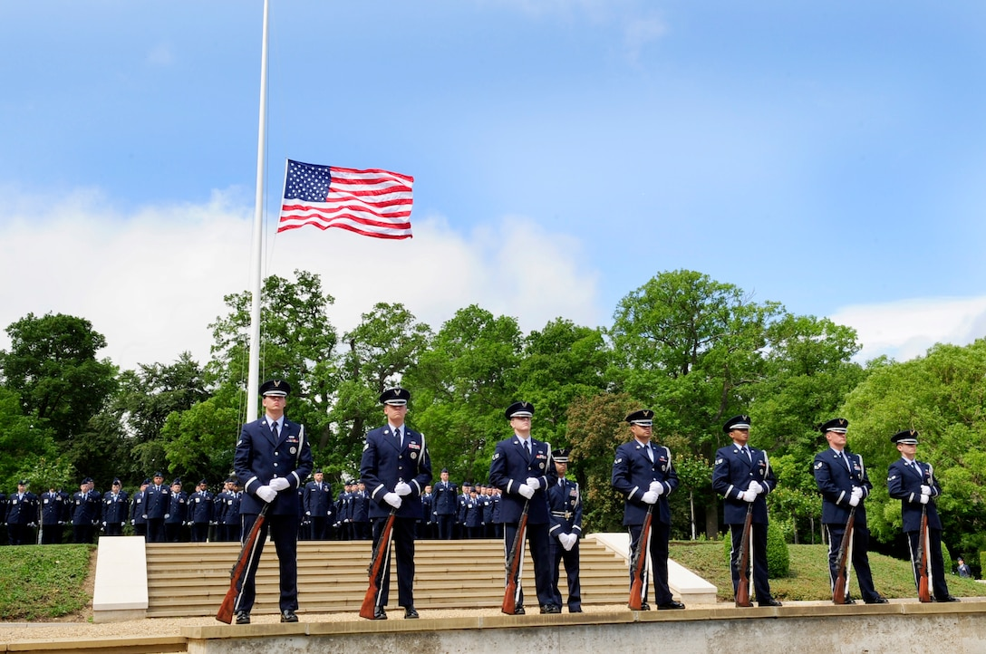 Cambridge, England -- The RAF Mildenhall Honor Guard provides ceremonial services during the Madingley American Cemetery Memorial Service in Cambridge May 30, 2011. The honor guard also performed a three-volley salute during the service in remembrance of fallen heroes. (U.S. Air Force photo/Senior Airman Ethan Morgan)