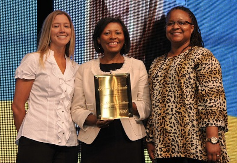 Shannon Norris, Joint Base Charleston – Air Base Youth Programs director (left) and Paula Matthews, JB CHS – AB School Age Program Coordinator (right) accept the Honor Award for Overall Program Excellence from April Hawkins, MetLife Foundation Civic Affairs Program director during the Boys & Girls Clubs of America's 105th national conference held recently in New Orleans, La. (courtesy photo)
