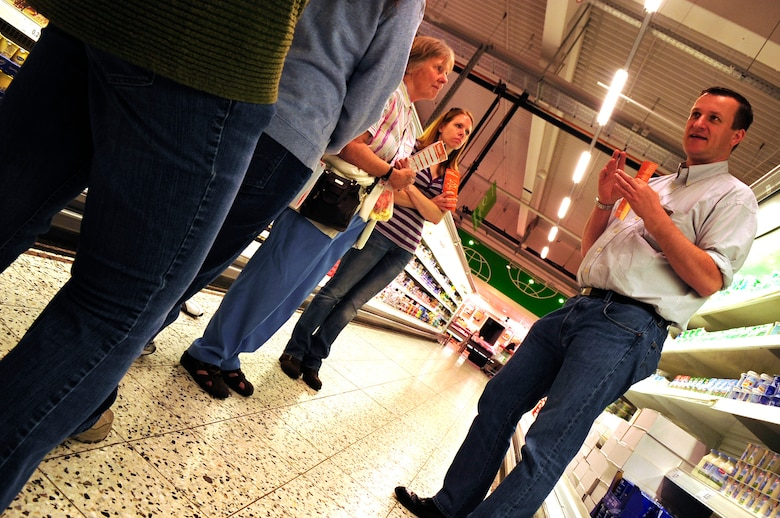 Hagan Volke, cultural adaptation liaison officer with the Ramstein, AB Airman & Family Readiness Center explains shopping on the local economy to members of the first What is What class at a local supermarket, May 26, 2011, Kaiserslautern, Germany. The program was designed to give hands on experience to members of the Department of Defense in shopping on the local economy. (U.S. Air Force Photo by. Tech. Sgt. Jocelyn L. Rich)