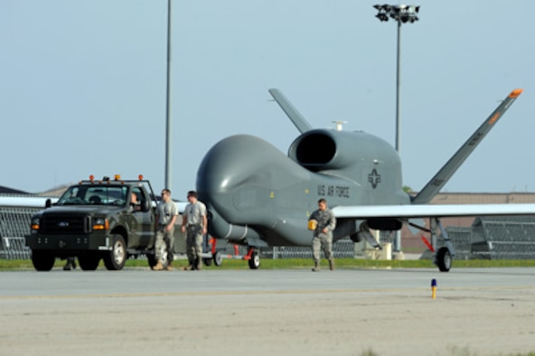 Airmen from Grand Forks Air Force Base, N.D., welcome the first RQ-4 Global Hawk to the base May 26, 2011. The arrival marked the beginning of a new era of remotely piloted aircraft at the base. (U.S. Air Force photo/Tech. Sgt. Johnny Saldivar)