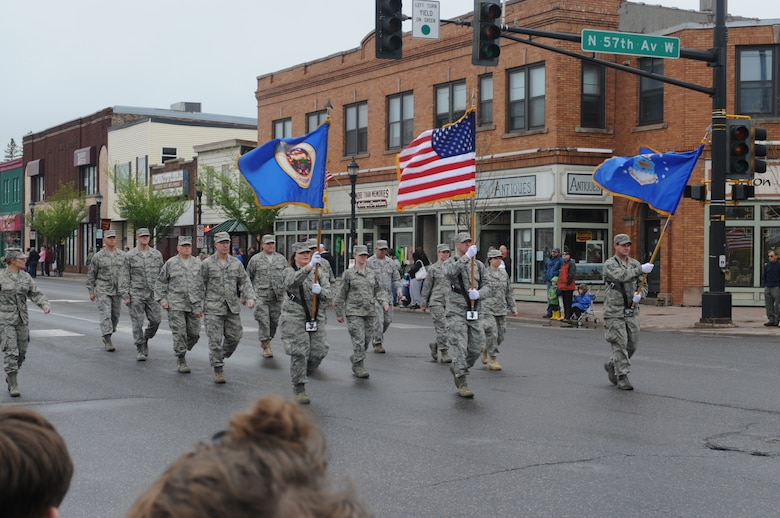 Members of the 148th Fighter Wing, Duluth, Minn. march down Grand Avenue for the Memorial day parade in Duluth Minn. on May 30, 2011.  The rainy weather held out long enough for the parade to go on as planned and went through the West End of Duluth. (U.S. Air Force photo by Staff Sgt. Donald Acton/released)