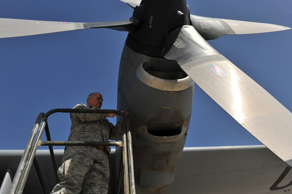 Tech. Sgt. Donald Debord, 455th Expeditionary Aircraft Maintenance Squadron crewchief, opens an engine cowling during a routine inspection on a C-130 Hercules at Bagram Airfield, Afghanistan, June 2, 2011. Sergeant Debord is deployed from the 166th Aircraft Maintenance Squadron, Delaware Air National Guard, Del., and is a native of New Castle, Del.  (U.S. Air Force photo by Senior Airman Sheila deVera)
