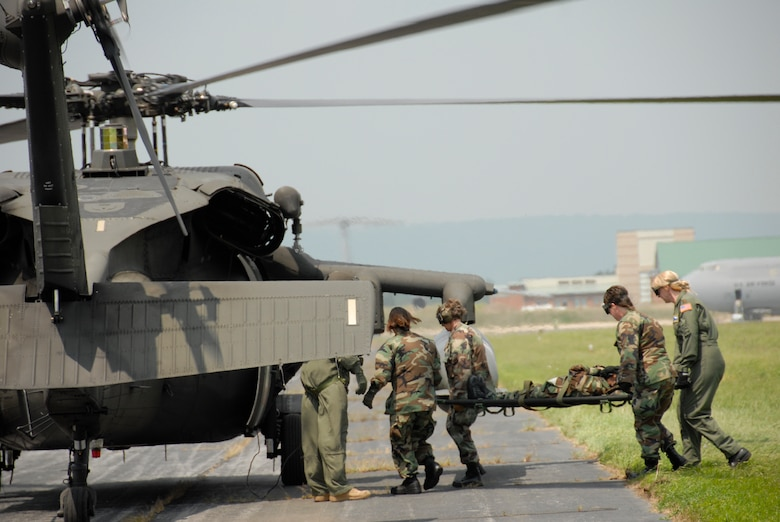 Members of the 167th Aeromedical Evacuation Squadron load a simulated patient aboard a UH-60 Black Hawk during a local training exercise, Martinsburg, W.Va., Aug. 2, 2008. Aeromedical members train loading and off-loading patients in various airframes and environments. (U.S. Air Force photo by Master Sgt. Emily A. Beightol-Deyerle)