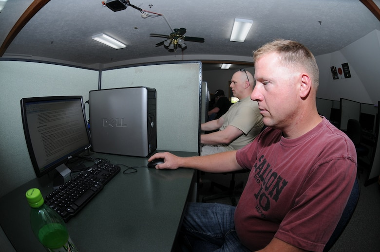 PIERRE, S.D. -- Master Sgt. Eric Wollan, right, from the 114th Fighter Wing Safety office, and Staff Sgt. Joe Wiskur, from the 114th Fighter Wing Aviation Resource Management office, browse the internet while off duty at the Pierre Indian Learning Center Internet Cafe Wednesday, June 1, 2011.The Center opened the campus for 650 Soldiers and Airmen who have been activated as part of flood relief efforts along the Missouri River. (SDNG photo by Capt. Michael Frye) (RELEASED)