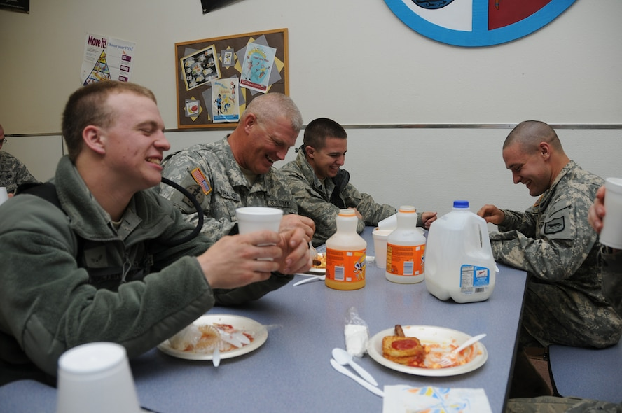 PIERRE, S.D. -- Soldiers and Airmen from the South Dakota National Guard visit during breakfast at the Pierre Indian Resource Center here Thursday, June 2, 2011. Pictured from left to right are Airmen First Class Todd Suurmeyer, Staff Sgt. James Reinhardt, Airman First Class Casey Schoellerman, and Cadet Peter Bendorf. Suurmeyer and Schoellerman are both crew chiefs with the South Dakota Air National Guard, while Reinhardt and Bendorf are both from the 1st/147th HHB. The Center opened the campus for 650 Soldiers and Airmen who have been activated as part of flood relief efforts along the Missouri River. (SDNG photo by Capt. Michael Frye) (RELEASED)