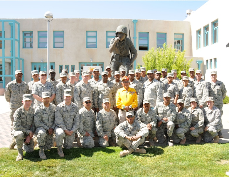 "Members of the 113th Civil Engineer Squadron (113th CES), District of Columbia Air National Guard, pose with Bill Toledo, an original Navajo ""Code-Talker"" from World War II, following a speech by Toledo in which Toledo relayed his experiences during the war.  The 113th CES members are in Window Rock, Ariz., as part of the Innovative Readiness Training, a civil-military affairs program linking military units with civilian communities for humanitarian projects.  (U.S. Air Force Photo by Tech Sgt. Craig Clapper)"