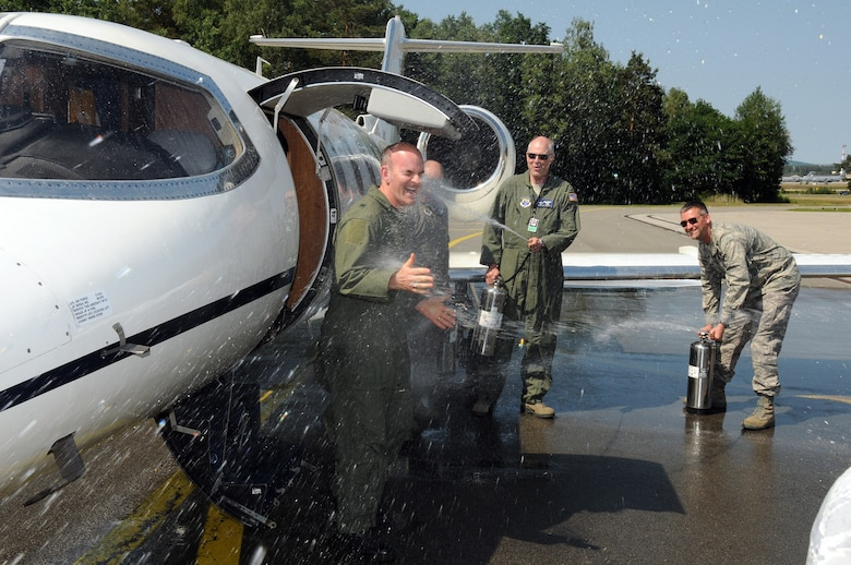 RAMSTEIN AIR BASE, Germany -- 17th Air Force Vice Commander Brig. Gen. Mike Callan (left) gets hosed down after his Fini Flight June 2, 2011 here. Doing the hosing are 617th Air and Space Operations Center Master Sgts. Billy Mason (behind the General), Ray Hensley (center) and Col. Matthew Smith (right). The 617th Airmen were joined by more than a 100 well-wishers from 17th AF and the 76th Airlift Squadron to celebrate the culmination of General Callan's 30 distinguished years of service to the Air Force and his country. (U.S. Air Force photo by Master Sgt. Jim Fisher)
