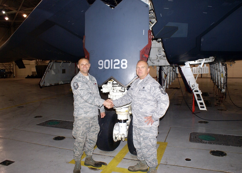 """Master Sgt. Craig Kuzara is congratulated by Chief Master Sgt. Steven Rolwes on Kuzara's appointment as the first Air National Guardsman Dedicated Crew Chief (DCC) for a B-2 aircraft.  Kuzara will be DCC for the """"Spirit of Nebraska.""""  Kuzara and Rolwes are members of the 131st Bomb Wing Maintenance Group, Missouri Air National Guard at Whiteman AFB.  (Photo by Chief Master Sgt. Dan Peters)"""