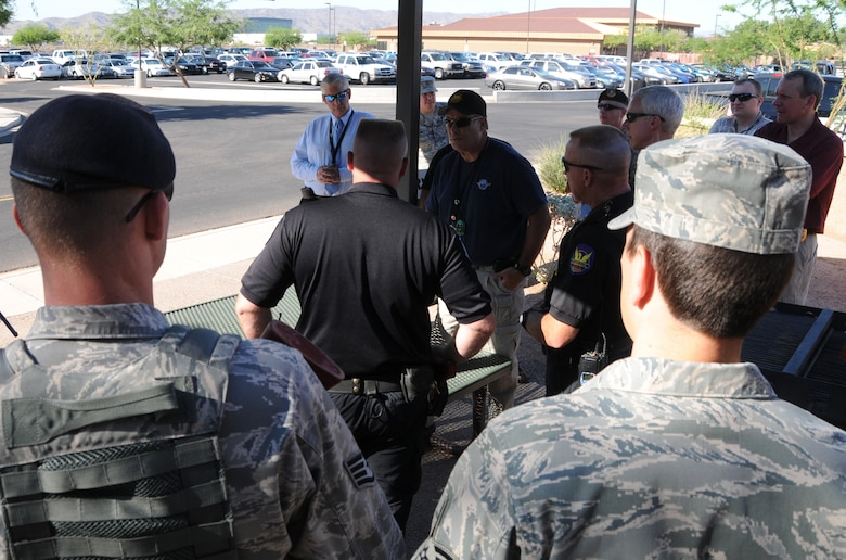 During an active shooter exercise, members of the Air National Guard, the Phoenix Police Department, the Federal Aviation Administration and the Transportation Security Agency work together to execute proper breaching and clearing techniques, at the 161st Air Refueling Guard base, Phoenix, June 4, 2011. This exercise helps to improve interagency communication and coordinate strategic planes. (U.S. Air Force photo by Staff Sgt. Courtney Enos/Released)