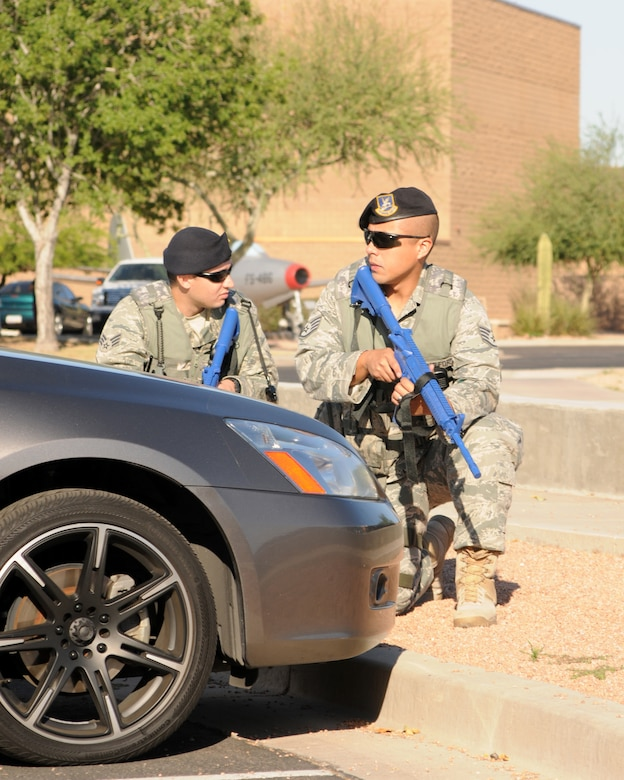 Us. Air Force Staff Sgt Brandon Gabriel        and SrA Joshua Ridgey during an active shooter exercise at the 161st Air Refueling Wing in Phoenix Ariz. on June 4, 2011.  The exercise allowed joint forces to work together in case of an emergency situation. (U.S. Air Force photo by A1C Rashaunda Williams/Released)