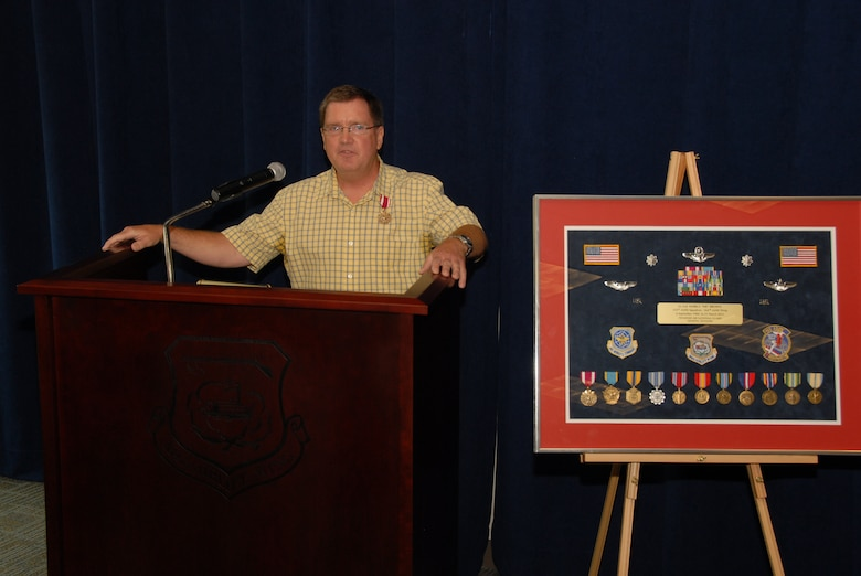 Mark E. Brown, retired Lieutenant Colonel, speaks to the crowd of his retirement ceremony, held June 4th, 2011, after being presented with a career shadow box.