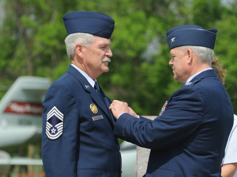 Col. Michael Wobbema, the North Dakota National Guard director of joint staff and assistant adjutant general for air, pins the Defense Meritorious Service Medal onto the jacket of Chief Master Sgt. James Clemenson, left, June 4, during Clemenson's retirement ceremony at the North Dakota Air National Guard, Fargo, N.D. Clemenson is the last enlisted Airman to have been stationed in Vietnam to retire from the Air Force.  Clemenson did two tours in Vietnam with the U.S. Army from October 1970 through April 1972. He joined the North Dakota Air National Guard in 1973 and has most recently served as the National Guard Bureau senior enlisted manager for the joint staff, Washington, D.C. He has served in the United States military for 41 years. Only one other active Airman, Chief Master Sgt. Jim Honeycutt, still remains in service that wears a Vietnam Service Ribbon, although it's for temporary duty in country versus a mobilization. Clemenson and Honeycutt's status is among active-duty Airmen and does not include drill status Guardsmen, on which no clear statistics were available.