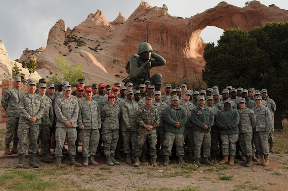 Members of the 113th DC ANG Civil Engineer Squadron assemble for a group shot at the Navajo Code Talkers Memorial, Window Rock, Ariz, May24, 2011 . Members of the 113th CES are in Window Rock, Az., as part of the Innovative Readiness Training, a civil-military affairs program linking military units with civilian communities for humanitarian projects. (U.S. Air Force Photo by Master Sgt. Paula Aragon)