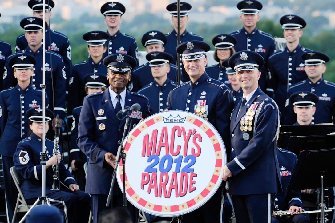Maj. Gen. Darren W. McDew, Col. A. Phillip Waite and Lt. Col. Raymond Powell display the Macy's Day Parade emblem June 4, at The Air Force Memorial, Arlington, Va, after receiving an invite for the U.S. Air Force Band and U.S. Air Force Honor Guard to perform during the 2012 parade. Originally known as the Christmas Macy's Day Parade, the annual event began in 1924, and is now known as the Macy's Day annual Thanksgiving Parade. (U.S. Air Force photo by Staff Sgt. Raymond Mills)
