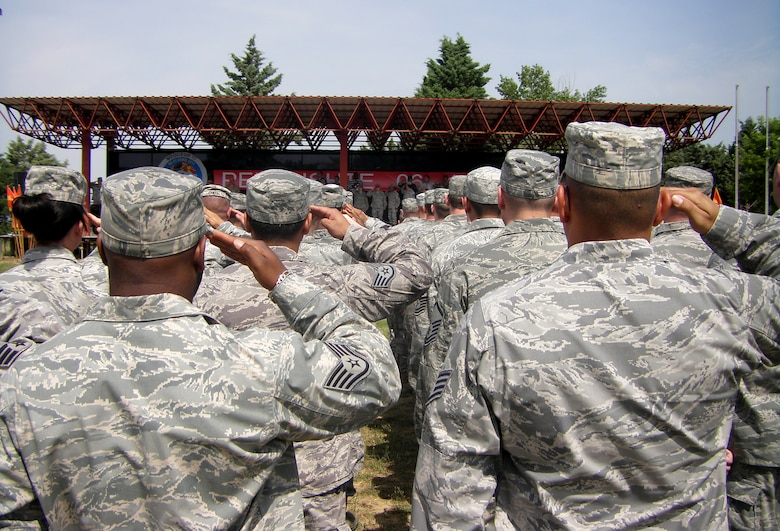 CAMP PEPELISHTE, Macedonia -- Members of the U.S. Air Force and Army salute during the Macedonian and American National Anthems at the opening ceremony of Medical Training Exercise in Central and Eastern Europe 2011 here June 6. The countries participating in this year's MEDCEUR are Macedonia, Montenegro, Bosnia and Herzegovina, Serbia, Slovenia, Norway and the United States. MEDCEUR is a Partnership for Peace and chairman of the Joint Chiefs of Staff-sponsored regional and multilateral exercise in Central and Eastern Europe designed to provide medical training and operational experience in a deployed environment.  (U.S. Air Force photo/Master Sgt. Kelley J. Stewart)