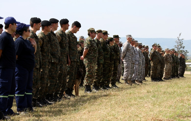 CAMP PEPELISHTE, Macedonia – Service members from Macedonia, Montenegro, Bosnia and Herzegovina, Serbia, Slovenia, Norway and the United States stand at parade rest during opening comments at the Medical Training Exercise in Central and Eastern Europe 2011 opening ceremony here June 6.  MEDCEUR is a Partnership for Peace and Chairman of the Joint Chiefs of Staff-sponsored regional and multilateral exercise in Central and Eastern Europe designed to provide medical training and operational experience in a deployed environment.  (U.S. Air Force photo/Master Sgt. Kelley J. Stewart)
