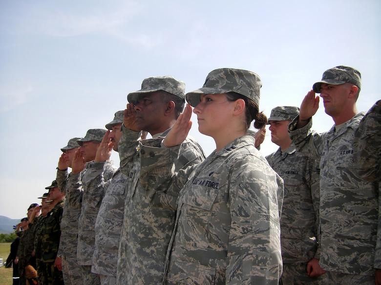 CAMP PEPELISHTE, Macedonia – Members of the United States Air Force and Army salute during the Macedonian and American National Anthems at the opening ceremony of Medical Training Exercise in Central and Eastern Europe 2011 here June 6.  The countries participating in this year's MEDCEUR are Macedonia, Montenegro, Bosnia and Herzegovina, Serbia, Slovenia, Norway and the United States.  MEDCEUR is a Partnership for Peace and Chairman of the Joint Chiefs of Staff-sponsored regional and multilateral exercise in Central and Eastern Europe designed to provide medical training and operational experience in a deployed environment.  (U.S. Air Force photo/Master Sgt. Kelley J. Stewart)