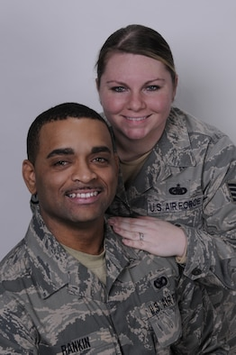 Staff Sgt. Christopher L. Rankin, a security forces specialist with the 130th Security Forces Squadron, 130th Airlift Wing, West Virginia Air National Guard, Charleston, W.Va. and his wife, Staff Sgt. Pauline Rankin, a supply technician with the 130th Logistics Squadron pose for a portrait in the 130th AW Public Affairs photography studio, Jan. 9. The staff sergeants joined the unit, Jan. 8, 2011.   Staff Sgt. Christopher L. Rankin, a native of Huntington, W.Va., who separated from the 130th SFS in November 2007, to be with his wife, a native of Greenoch, Scotland, who was on active duty at RAF Mildenhall in Suffolk, England at the time, said he's happy to be back in uniform.   The staff sgts. come to the unit from Fort Riley, Kansas, where Staff Sgt. Pauline Rankin was stationed as a supply liaison for a Tactical Air Control Party unit assigned to the 10th Air Support Operations Squadron.   Staff Sgt. Christopher L. Rankin will complete security forces refresher training and weapons requalification at the unit. The staff sergeants have been married for four years.