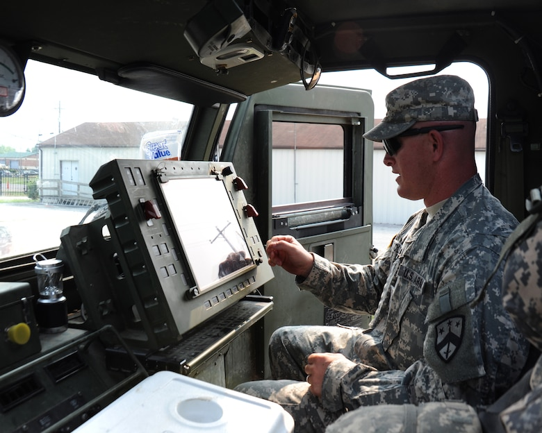Staff Sgt. Jeremy Coleman, A Battery, 1/181st Field Artillery Battalion, demonstrates how to use the GPS aided navigation system inside one of the HIMARS, June 4, 2011.