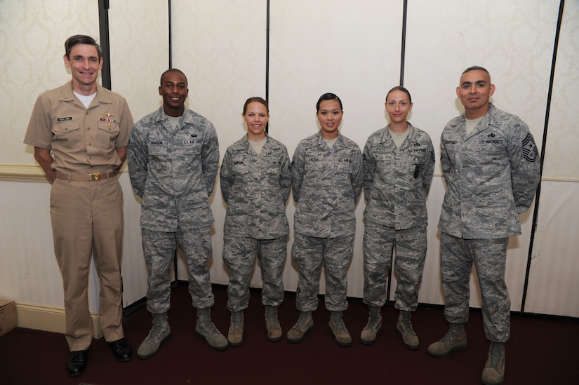 Navy Capt. Ralph Ward and Command Chief Master Sgt. Jose LugoSantiago pose with the June Diamond Sharp Award winners. (Left to right) Airman 1st Class Nathaniel Hopson from the 628th Communication Squadron, Airman1st Class Brandi Hansen from the 1st Combat Camera Squadron, Airman 1st Class Fatima Calisa from the 628th Force Support Squadron and Staff Sgt. Stephanie Pyles from the 628th Civil Engineer Sqaudron. The Diamond Sharp Award is presented to outstanding Airmen chosen by their respective first sergeants. Captain Ward is the Joint Base Charleston deputy commander. (U.S. Air Force photo/ Staff Sgt. Nicole Mickle)