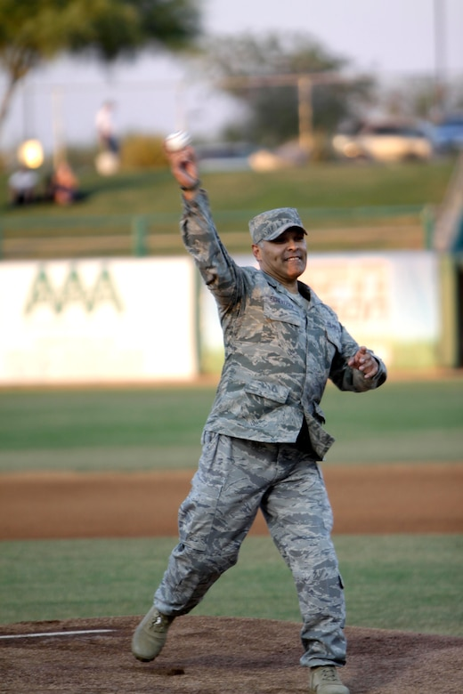 Tech. Sgt. Manny Echeverria, a four-time veteran of Operation Iraqi Freedom and two-time veteran of Operation Enduring Freedom, throws out a first pitch at Kino Memorial Stadium June 5. (U.S. Air Force photo/Tech. Sgt. Hollie Hansen)