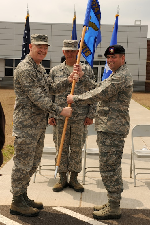 U.S. Air Force Maj. Patrick Cox accepts the 274th Air Support Operations Squadron (ASOS) flag from Col. Kevin Bradley during a change of command ceremony held on June 5, 2011 at Hancock Field Air National Guard Base, Syracuse, NY.  Maj. Cox assumed commander of the 274 ASOS from Lt. Col. Alberto Gaston.