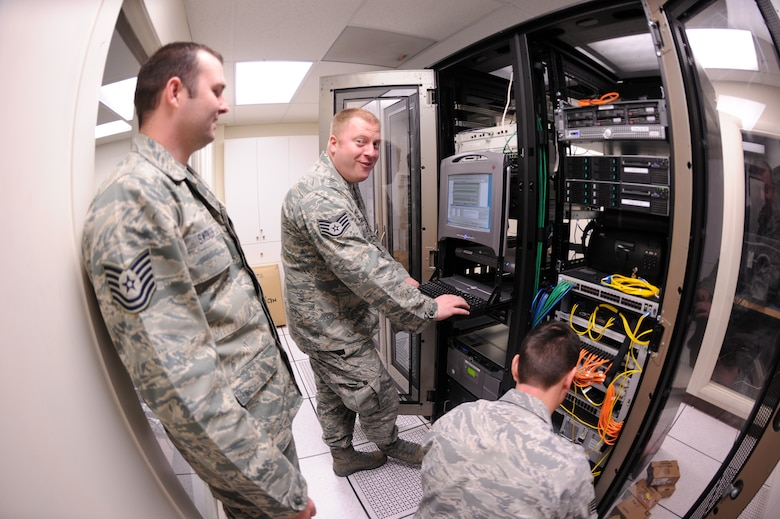 Tech Sgt. Jason Swensen, Staff Sgt. Joe Allen and Staff Sgt. Harvey Williams finish configuring an Information Transfer Node (ITN) during a network upgrade to communications equipment at Gowen Field, Boise, Idaho on May 1st. Swensen, Allen and Williams are members of the 124th Communications Flight that worked to upgrade the base telecommunications network. (U.S. Air Force photo by Tech. Sgt. Heather Walsh)