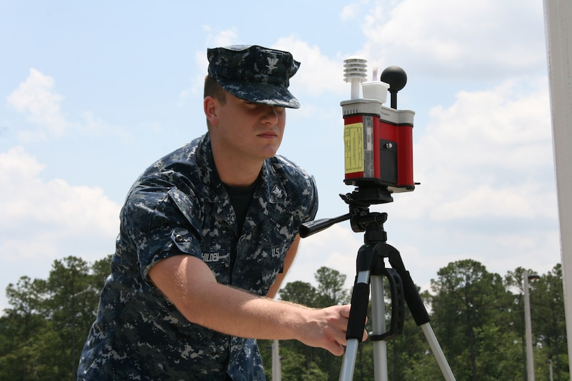 Hospital Corpsman Third Class Kyle Hilden checks the Wet Bulb Globe Temperature at Naval Health Clinic Charleston hourly during the summer months to ensure the most accurate and current heat stress conditions are relayed to base personnel. HM3 Hilden is a Preventive Medicine Technician assigned to Naval Health Clinic Charleston. (U.S. Navy photo/Jeff Kelly)
