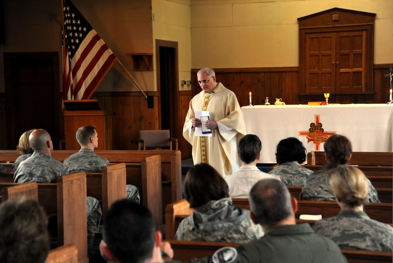 Air Force Lt. Col. Rick Sirianni delivers the Homily during mass held on May 15, 2011 at the Portland Air National Guard Base, Portland, Ore., during the 142nd Fighter Wing Unit Training Assembly. This was Father Sirianni's last mass before he retires from the Oregon Air National Guard after 23 years of service. (U.S. Air Force photograph by Tech. Sgt. John Hughel) (Released)