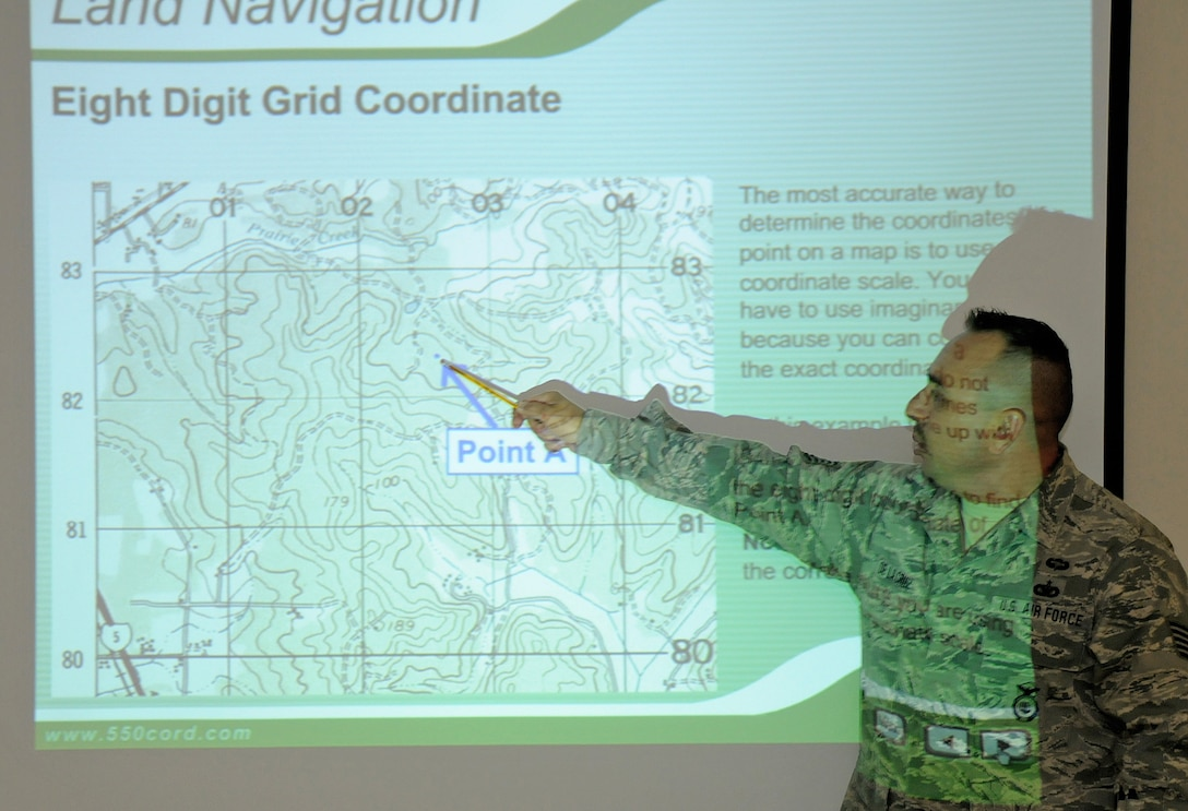 Technical Sergeant Marco De LaCruz, a member of the 146th Security Force Squadron, 146th Airlift Wing, Channel Islands Air National Guard Station, Calif. conducts a map reading course for 146 SFS personnel in preperation for an upcoming land navigation exercise. The 146 AW sent three squadrons to Joint Base Elmendorf-Richardson, Anchorage, Alaska on Saturday, June 4, 2011. The Air Terminal Operations Squadron, Logistics Readiness Squadron, and the Security Force Squadron moved down range to complete there respective annual training requirements.