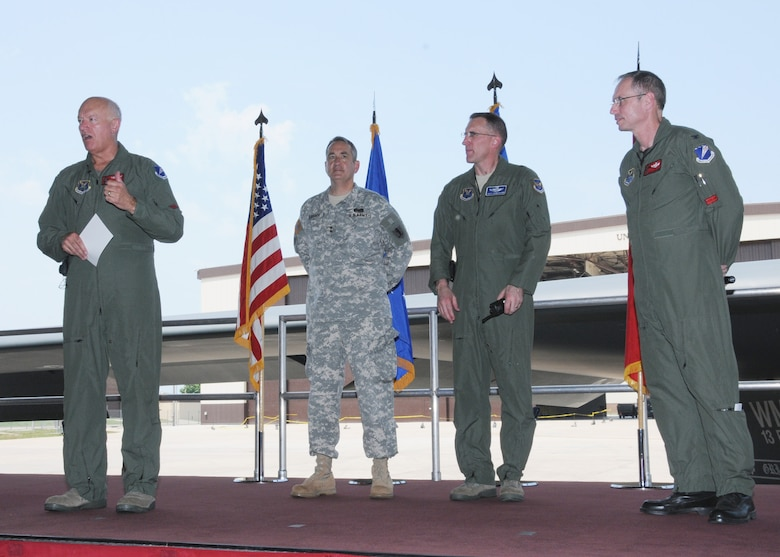 """Lt. Gen. Harry M """"Bud"""" Wyatt III, Air National Guard Director, addresses 131st Bomb Wing Missouri Air National Guard personnel at a Wing all call, June 4, to celebrate the unveiling of the 131st wing patch onto the B-2 """"Spirit of Missouri. """"   Left to right:  Wyatt, Maj. Gen. Stephen Danner, Adjutant General for the Missouri National Guard, Brig Gen. Scott Vander Hamm, 509th Bomb Wing commander, Col. Greg Champagne, 131st Bomb Wing commander.  (U.S. Air Force photo by Master Sgt. Mary-Dale Amison)"""