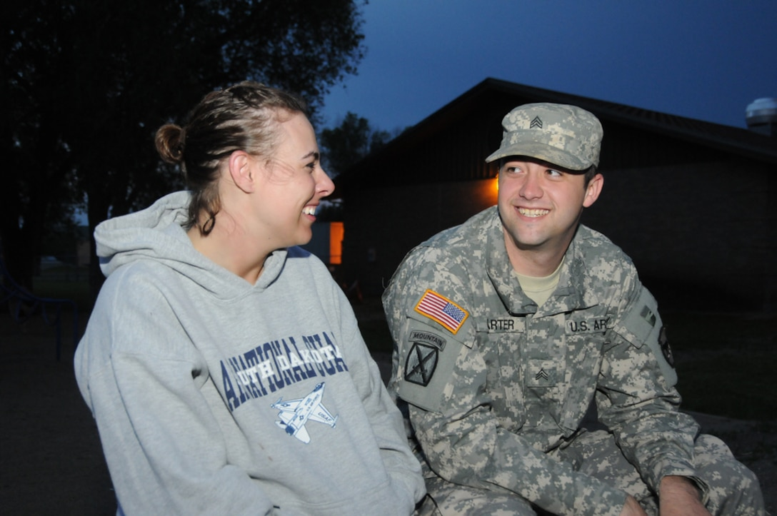 PIERRE, S.D. – Staff Sgt. Megan Carter, 114th Fighter Wing, and Sgt. William Carter, 147th Field Artillery, are a married couple from Sioux Falls, S.D. were both called to state active duty by their individual units to help with flooding operations along the Missouri River in Pierre.  Megan works the day shift, while William works nights, making it difficult to see each other.  They have a baby at home who took her first step while they were placed on state active duty in support of the historic flooding event along the Missouri River in Pierre.  (SDNG photo by Master Sgt. Christopher Stewart)(Released)
