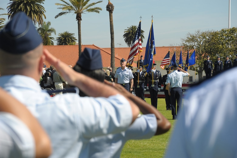 Airmen standing in formation salute the flag during the SMC change of command ceremony, June 3. Lieutenant Gen. Ellen Pawlikowski assumed command from Lt. Gen. Tom Sheridan at a ceremony officiated by Gen. William Shelton, Air Force Space Command commander, and attended by more than 500 family, friends, community leaders and SMC personnel. (Photo by Joe Juarez)