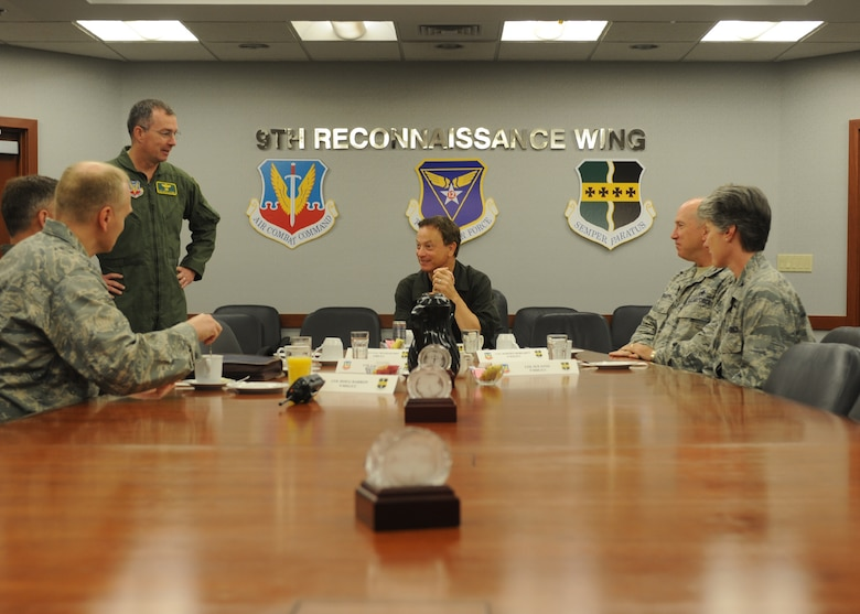 Gary Sinise, actor and military supporter, receives the 9th Reconnaissance Wing Unit mission brief from Brig. Gen. Paul McGillicuddy, 9th RW commander, June 7, 2011 prior to beginning the training to take a high flight to 70,000 feet in the U-2 Dragon Lady. Mr. Sinise was visiting Beale to document the mission of the U-2 Dragon Lady and meet with Airmen to boost morale.