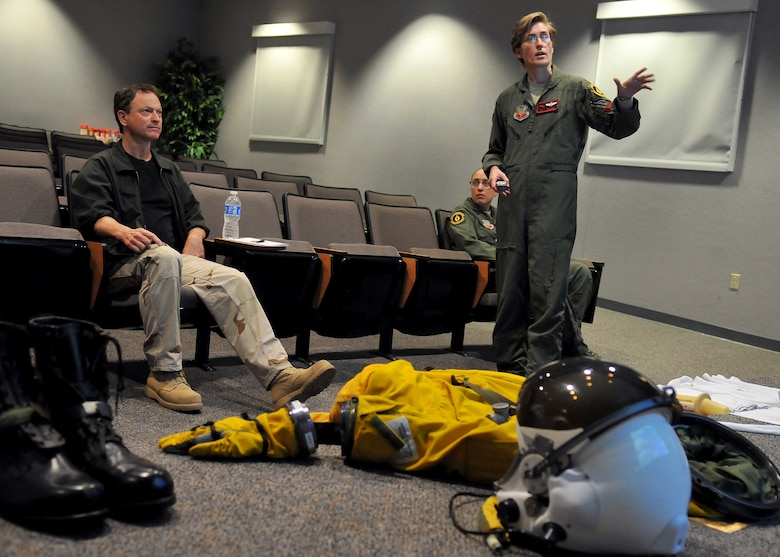 Gary Sinise, actor and military supporter, receives a pre-flight briefing from Princess about the implements and functions of the U-2 flight suit June 7, 2011 at the 9th Physiological Support Squadron, Beale Air Force Base, Calif. Mr. Sinise was visiting Beale to document the mission of the U-2 Dragon Lady and meet with Airmen to boost morale.